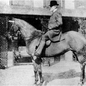 Mr May on one of his hunter horses outside Valence House