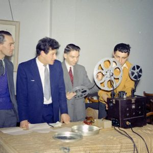 Members of the Dagenham Co-operative Film Society around a projector, 1950s