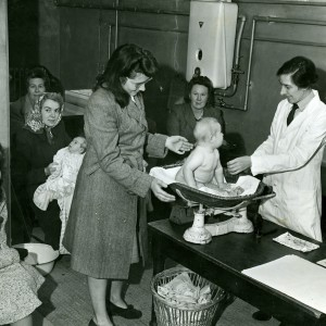 Dagenham Child Welfare Clinic in 1947 showing a baby being weighed