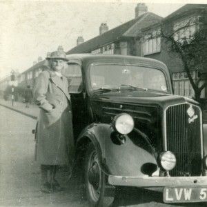 Midwife Minnie Goodbun with the car given to her by the local authority