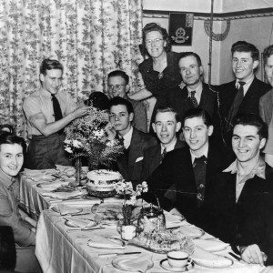 Pheobe Norris Kirk standing around a dinner table at Chirstmas 1948 with friends from Germany