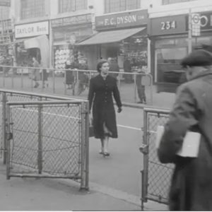 Woman crossing the road on the Heathway with shops in the background